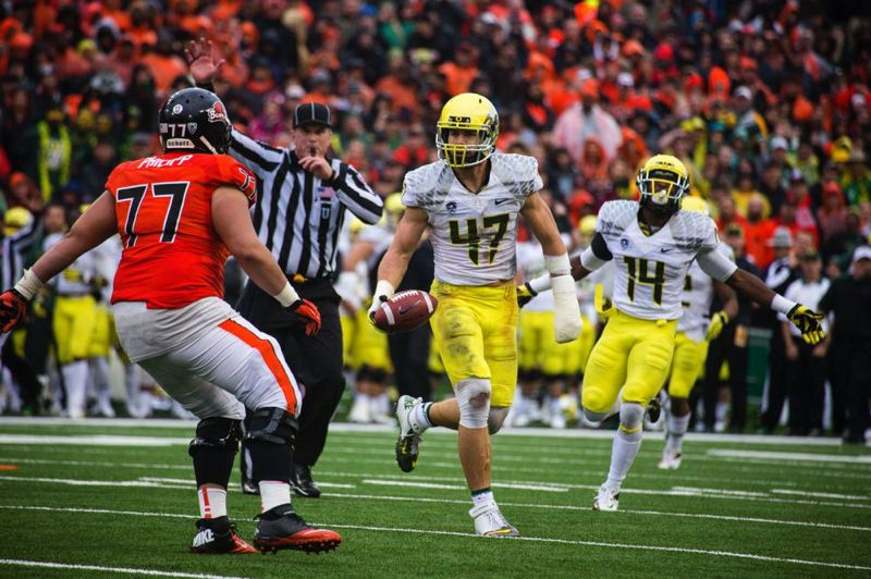 by: TRIBUNE PHOTO: CHRISTOPHER ONSTOTT - Oregon linebacker Kiko Alonso heads off the field after making a fourth-quarter interception at the Oregon State 23-yard line during the Ducks' Civil War victory Nov. 24. The pick set up a touchdown that gave Oregon a 48-17 lead en route to a 48-24 victory.