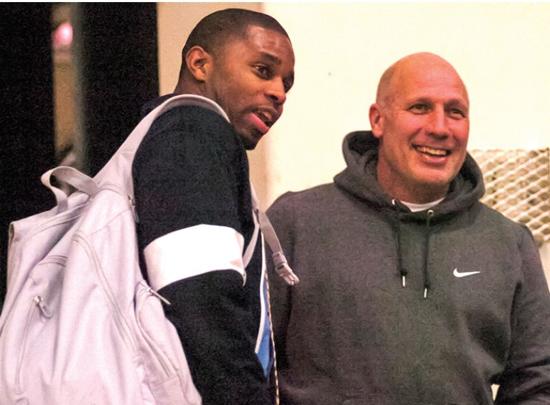 by: STAFF PHOTO BY DAVID BALL - Liberty boys basketball coach O.J. Gulley (left) reminisces about his time at Reynolds during a recent non-league game.