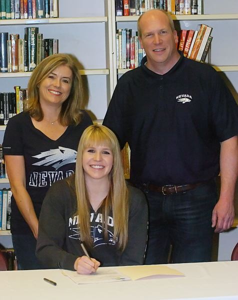 by: DAN BROOD - IT'S OFFICIAL -- Kathryn Groenweghe, with her parents, Karen and Eric, signs to play college volleyball at the University of Nevada.