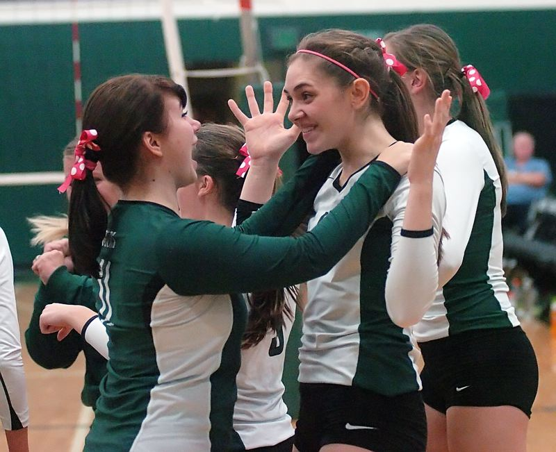 by: DAN BROOD - BIG, BIG WIN -- Tigard's Cassidy Freeman (left) and Meeka Mayhew celebrate following the Tigers' state playoff volleyball victory over Grant. It was the Tigers' first state playoff victory since 1992.