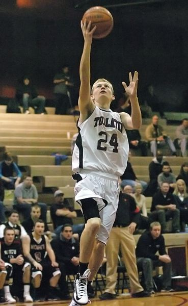 by: DAN BROOD - UP FOR TWO -- Tualatin High School senior Randall Tainer goes up to the basket during the Timberwolves' game with North Salem on Tuesday. Tainer scored a game-high 27 points in the 96-81 victory.