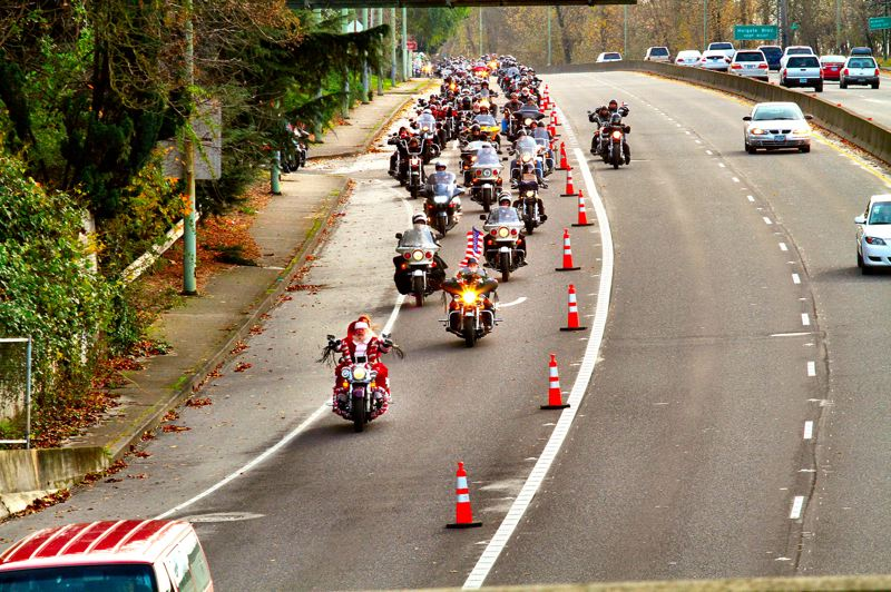 by: DAVID F. ASHTON - Followed by thousands of motorcyclists, Santa himself leads the procession northward along S.E. McLoughlin Boulevard, before making the turn to go west on the Ross Island Bridge up to Marquam Hill and the Shriners' Hospital for Children there.