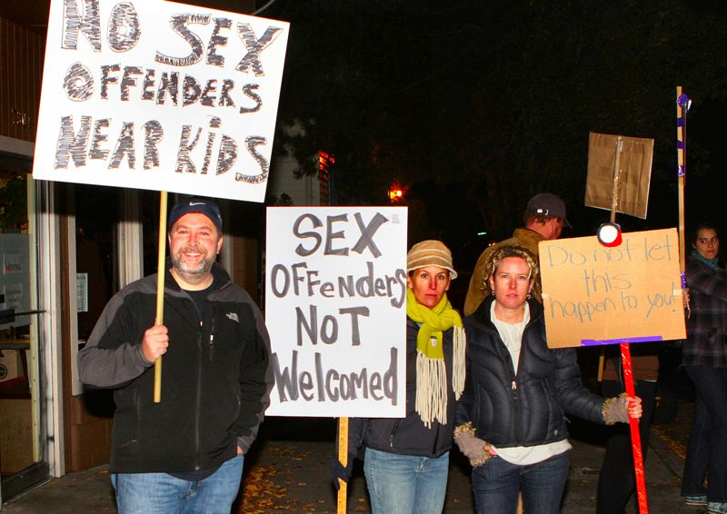 by: DAVID F. ASHTON - Sex Offender protestors