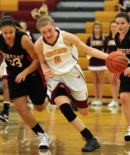 by:  JONATHAN HOUSE - Milwaukie senior guard Alexis Noren (2), pictured on the attack in the Mustangs season opener with Oregon City, has been  a sparkplug for the Mustangs this season, averaging 15 points, 4.8 assists, 6.2 rebounds and 4.4 steals in Milwaukies first five games.
