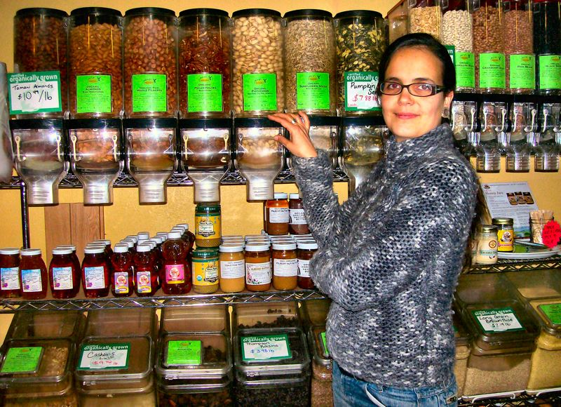 by: RITA A. LEONARD - Rebecca Andersson, founder of Brooklyn's new organic grocery store, indicates some of the many products on hand.
