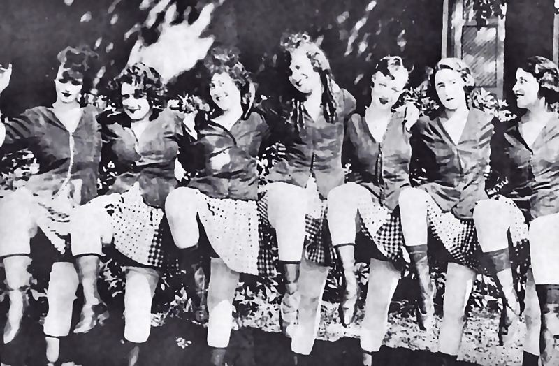 by: COURTESY OF SMILE HISTORY COMMITTEE - These lively dancing ladies's were part of the free entertainment offered in summer stage shows. The Oaks Park Chorus Line would dance onto the stage, singing popular songs and kicking up their heels.