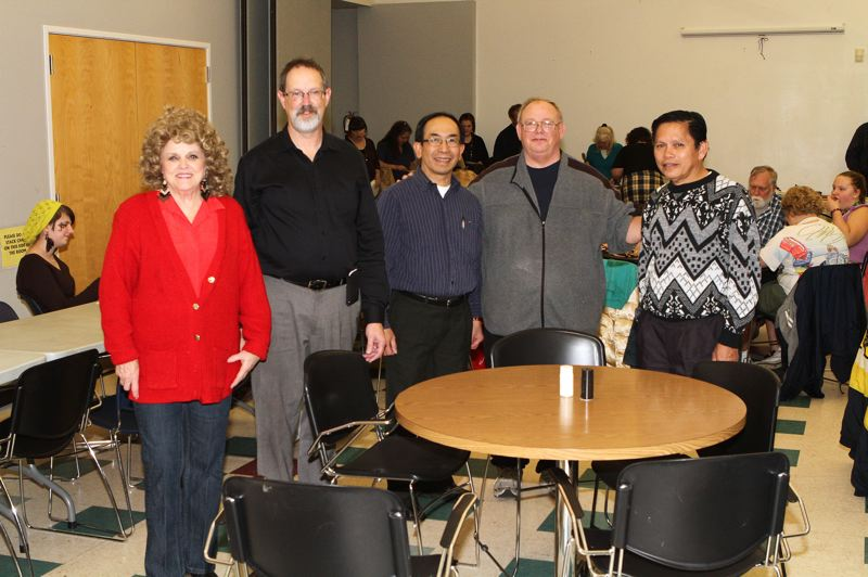 by: DAVID F. ASHTON - Healing Hearts & Mending Fences Ministry's Pastor Amy Stoner, Bethel Assembly of God Pastor Gary Russell, Vietnamese Faith Christian Church Pastor Thai Nguyen, Heaven Bound Christian Center Pastor David Webster, and Filipino Community Pastor Eli Dandasan, all gather at the multicultural dinner of thanks.