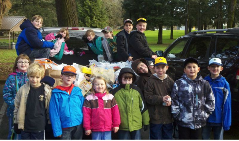 by: SUBMITTED PHOTOS - Members of Oregon City's Cub Scout Pack 470 proudly pose in front of a pickup loaded with cans (above) that they sorted and collected throughout the day (below).