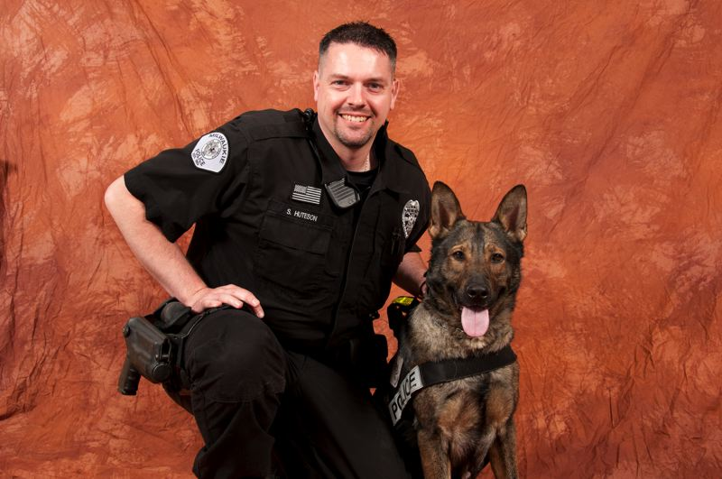 by: PHOTO BY ADAM BACHER - Milwaukie Police Officer Scott Huteson and his canine partner, Jag, are photographed earlier this year as a benefit for the annual 9K for K9 Walk downtown.