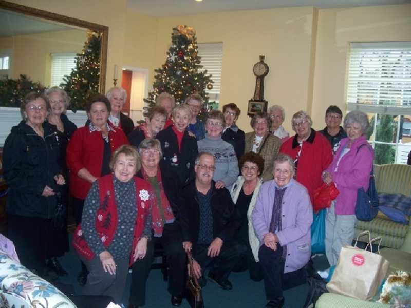 by: SUBMITTED PHOTO  - A group of WLACC seniors pose before sitting down to an Albertina Kerr luncheon.