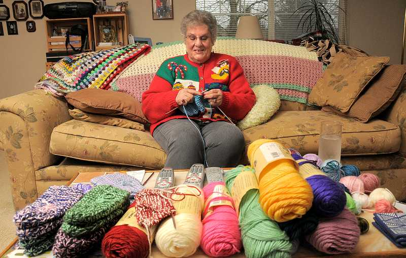 by: REVIEW, TIDING PHOTO: VERN UYETAKE  - West Linn resident Rita Perry knit 260 slippers for the West Linn Food Pantry.