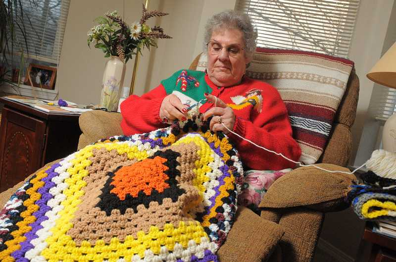 by: REVIEW, TIDING PHOTO: VERN UYETAKE  - Perry turned her crafty pastime into a good cause. Her slippers will go into holidy baskets delivered by the West Linn Food Pantry.