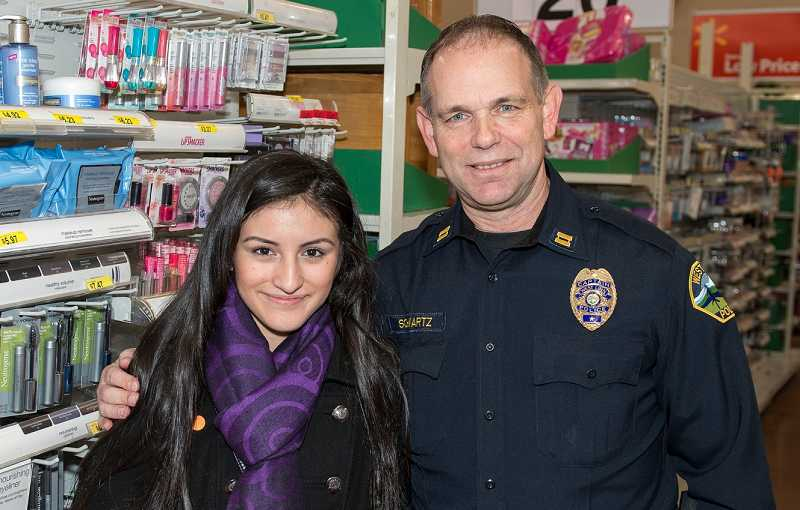 by: JOHN HIGGINS - Capt. Ron Schwartz with the West Linn Police Department participated for the first time in the Shop With a Cop event at Walmart on Dec. 15.