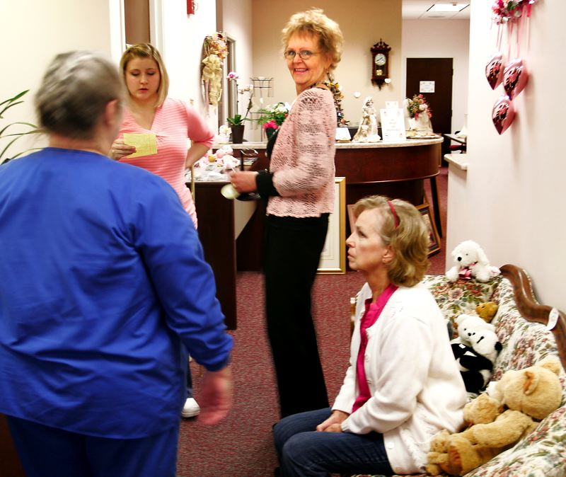 by: OUTLOOK PHOTO: JIM CLARK - Mary Barnhart talks to health care workers who came to her Gresham office for an estate sale. After 25 years as a doctor and surgeon, Barnhart retired in November.