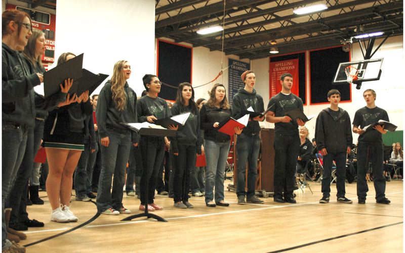 by: NEWS PHOTO: SCOTT JORGENSEN - Members of the Estacada High School choir sign Christmas songs at Eagle Creek Elementary School.