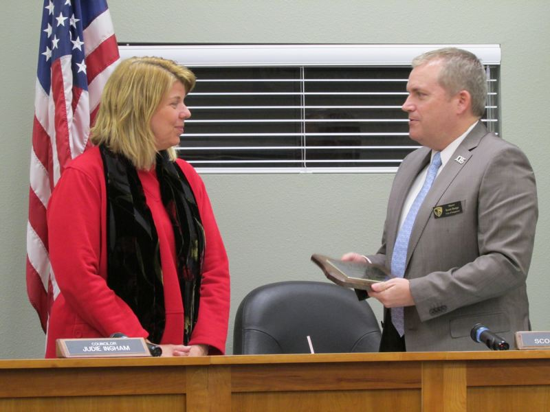 by: SPOTLIGHT PHOTO: KATIE WILSON - Scapppoose Mayor Scott Burge, right, presents departing city councilor Judie Ingham with a plaque of appreciation. Ingham decided to resign after the November election.