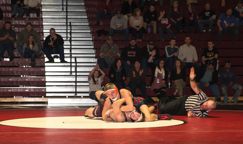 by: CONTRIBUTED PHOTO: JOSH WHITE  - Devon White, wrestling at 170 pounds, pinned Sherwoods James Musser last Thursday when Sandy won 63-18 at Sandy High School.