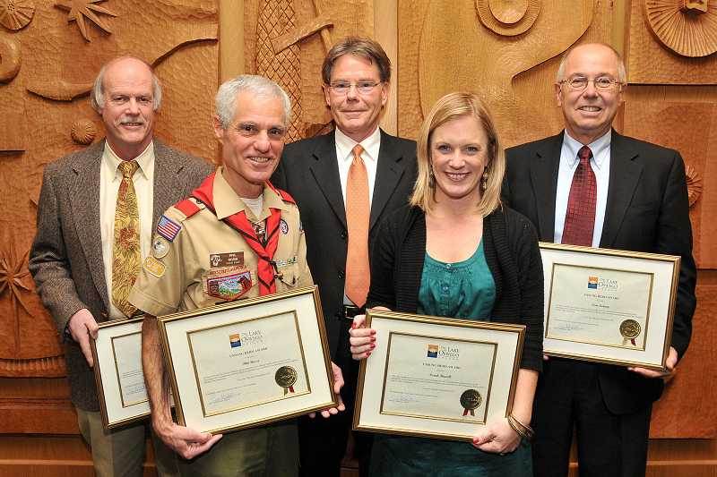 by: REVIEW PHOTO: VERN UYETAKE - The Lake Oswego Unsung Heroes of 2012 display the certificates of honor they received at a city council meeting Tuesday night. From left are Alan Mela, Phil Rossi, Michael McConnell, Sarah Howell and Tom Carey.