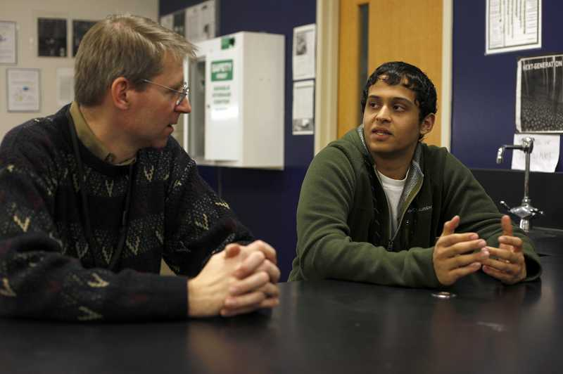 by: JONATHAN HOUSE - Raghav Tripathi talks with science teacher Brad Helsel last Friday about his research.