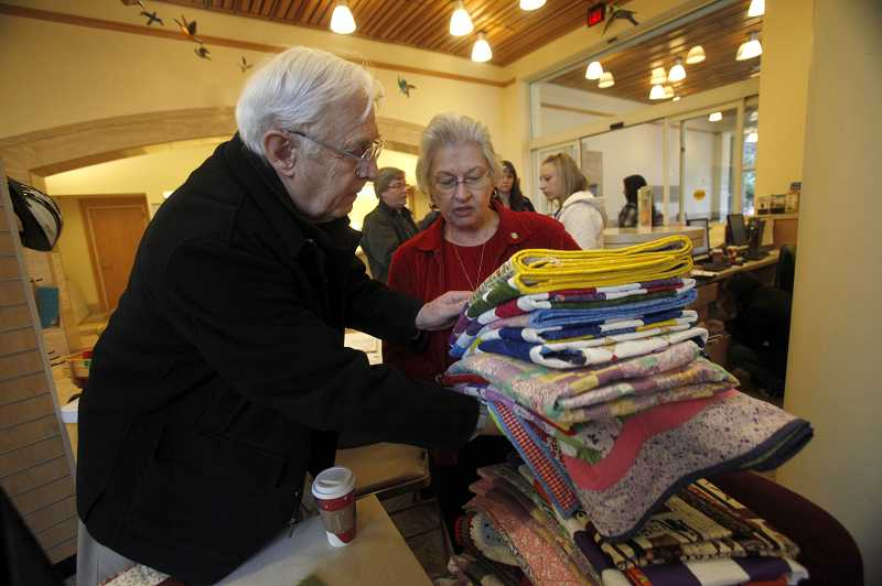 by: TIMES PHOTO: JONATHAN HOUSE - Wayne and Barbara Hess drop off nearly two dozen handmade quilts to Doernbecher Children's Hospital Wednesday morning. Barbara spent three years making the quilts for the kids.