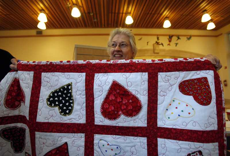 by: TIMES PHOTO: JONATHAN HOUSE - Barbara Hess enjoys going to different fabric stores and thrift shops, looking for interesting fabric designs that she can turn into a quilt for the kids of Doernbecher Children's Hospital.