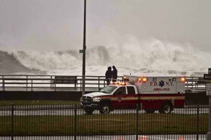 by: COURTESY OF MIKE VERKEST - Members of the New York Fire Department respond to incidents related to Hurricane Sandy shortly before the superstorm hit Rockaway Beach in October.