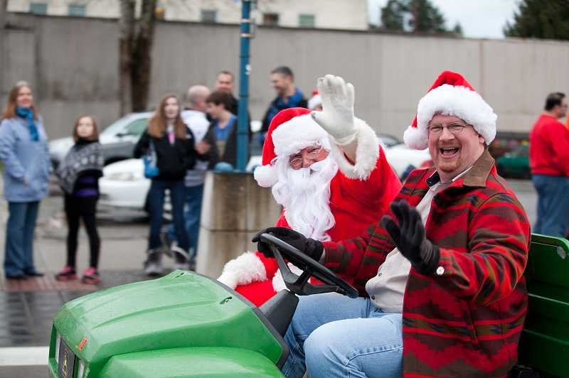 by: DARCI VANDENHOEK/KAZURI IMAGES - Mayor Keith Mays joins  Jolly Old St. Nick during the annual Winter Festival parade held Dec. 1 in Old Town Sherwood.