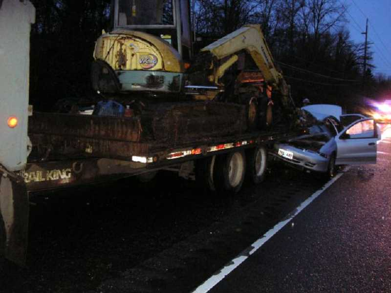 by: COURTESY OF OREGON STATE POLICE - A woman was seriously injured Wednesday morning after her car crashed nto the back of a utility trailer.