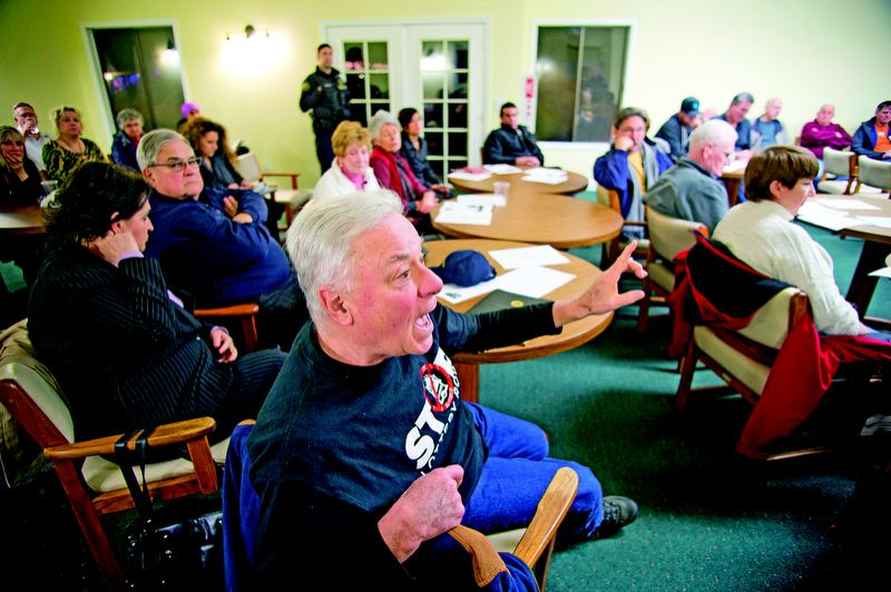 by: TRIBUNE PHOTO: CHRISTOPHER ONSTOTT - Retired judge Charles Kuffner was one of several Hayden Island residents grilling leaders of the Portland Police Bureau, Oregon State Lottery and the Oregon Liquor Control Commission at last week's neighborhood meeting on 'Lottery Row.'