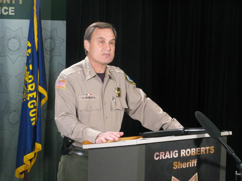 by: TRIBUNE PHOTO: CHRISTOPHER ONSTOTT - Clackamas County Sheriff Craig Roberts talks with reporters about the police response to the Dec. 11 shooting at Clackamas Town Center.