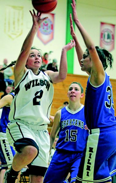 by: TRIBUNE PHOTO: JONATHAN HOUSE - Wilson's Molly Michelotti drives to hoop on Hillsboro. The Trojans, who dropped the Dec. 11 game 56-52, will compete in the Les Schwab Holiday Tournament Dec. 27-29 at Summit High School in Bend.