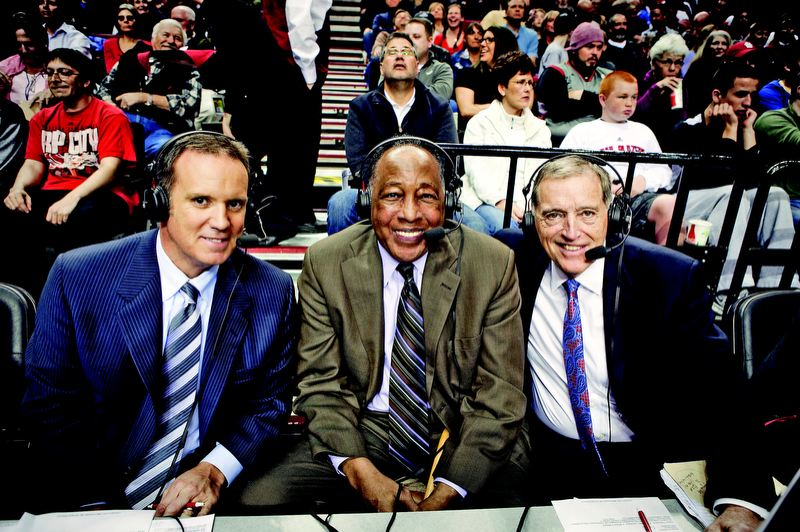 by: RYAN PROUTY/TRAIL BLAZERS - Mike Rice (right), at the courtside microphones with Trail Blazers broadcasting legend Steve Jones, has become a legend of his own with his memorable commentary during NBA games and shows.