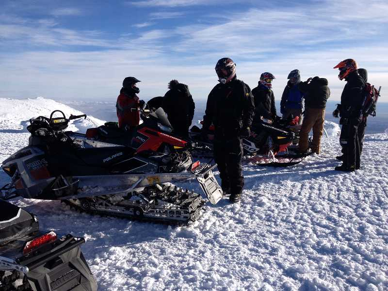by: BRANDON SEAVER - Seaver used his camera-phone to snap pictures during the ordeal, including this shot of rescue crews, who arrived after a blizzard stranded him on the mountain for four days.