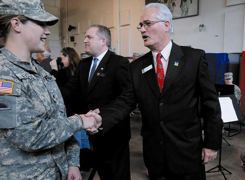 by: FILE PHOTO - Tigard Mayor Craig Dirksen welcomes home troops from the Oregon National Guard in 2011. The troops were stationed in Afghanistan and helped run transport missions.