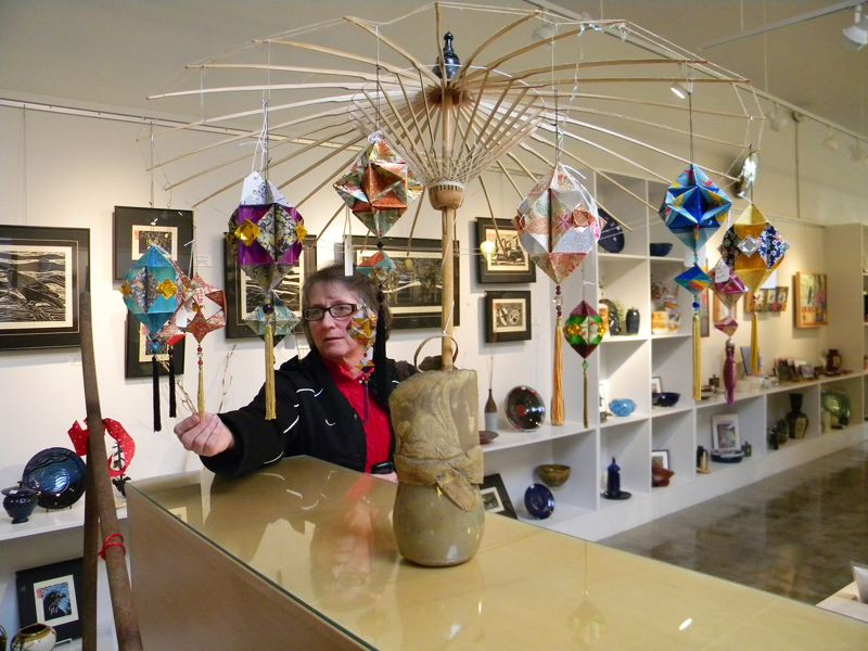 by: NEWS-TIMES PHOTO: JOANN BOATWRIGHT - Kathy Brooms origami ornaments caught the attention of Gales Creek resident Marilyn Dober when she shopped at Valley Art recently.
