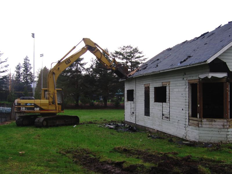 by: NEWS-TIMES PHOTO: JOHN SCHRAG - Dave Erickson of Daneal Construction in Newberg prepared to level a vacant house adjacent along Sunset Drive in Forest Grove on Monday morning.