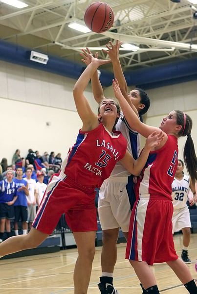 by: MILES VANCE - La Salle veterans Andrea Novak (15) and Natalie Schlechter (5) battle for a rebound in a game with Valley Catholic a year ago. The duo are among a host of experienced players returning to the Falcon varsity lineup this season.