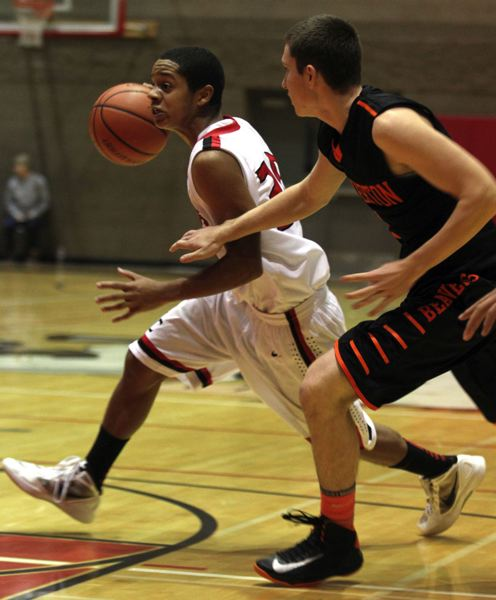 by:  JONATHAN HOUSE - Oregon City senior guard Valentino Polk goes on the attack in last Thursdays game with Beaverton.