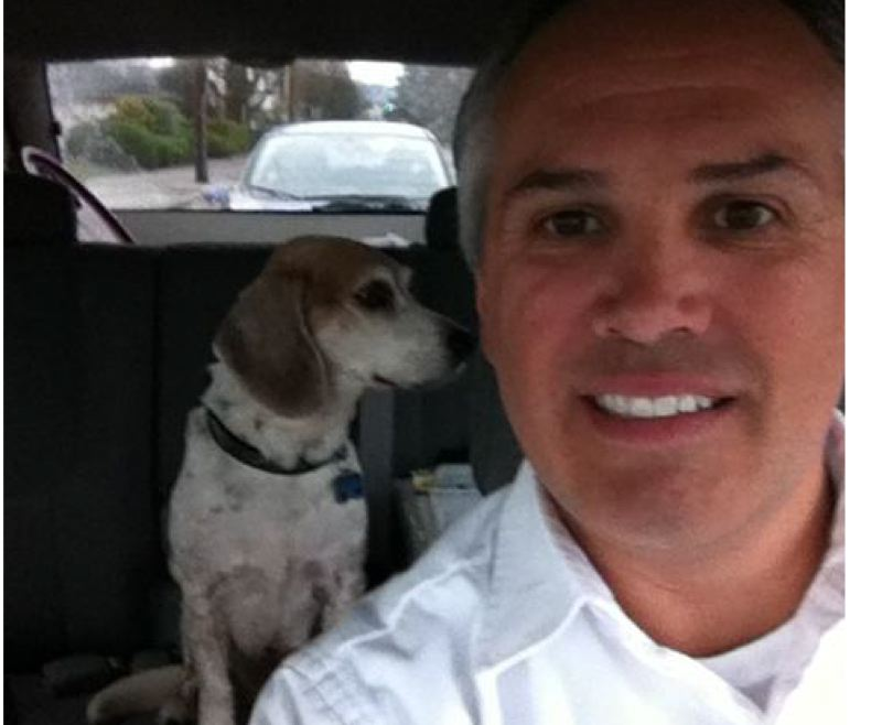 by: COURTESY OF TRIMET - Buster the beagle gets a ride home from TriMet Road Supervisor Jerry Zornado.