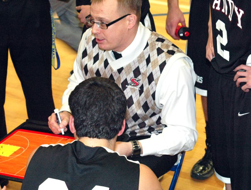 by: SANDY POST: PARKER LEE - Sandy head coach Jason Maki addresses his team during a timeout in Tuesdays 48-33 loss to Barlow.