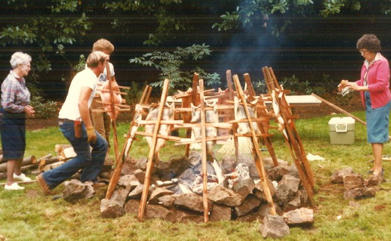 by: SUBMITTED PHOTO -  This historic photo shows a salmon bake in October 1982 involving Helga Mathews, Zel Adams and Jerry Herrmann, one of the instructors currently teaching a Northwest Native American history class through Oregon City Community Education. SUBMITTED PHOTO