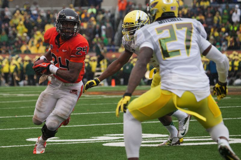 by: PAMPLIN MEDIA GROUP: MEG WILLIAMS - Oregon State running back Storm Woods tries to turn the corner during the Civil War last month.