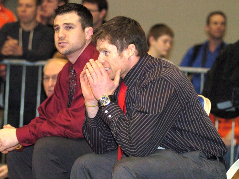 by: THE OUTLOOK: DAVID BALL - David Douglas head coach Ron Holyoak reacts from the corner of the mat during last years 6A state tournament. The Scots sneaked past Crater by half a point to take home the second-place trophy last season.