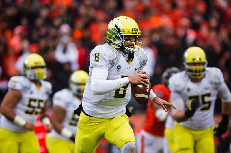 by: PAMPLIN MEDIA GROUP: CHRISTOPHER ONSTOTT - Oregon quarterback Marcus Mariota scrambles for a first down during the Ducks win over Oregon State in last months Civil War game. The freshman will direct the attack in next weeks Fiesta Bowl.
