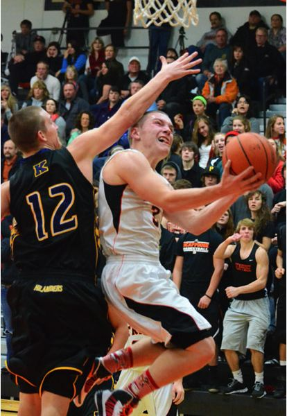 by: JOHN BREWINGTON - Scappoose's Zach Smith drives to the buck during last week's game with Kelso. Smith returned to action after missing the first part of the season. The Indians lost the game, 65-55.