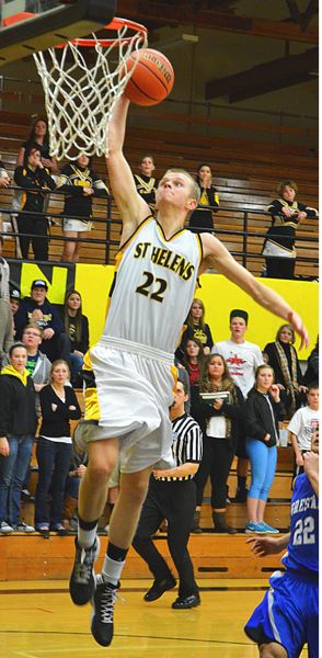 by: JOHN BREWINGTON - St. Helens' Jared Bonney goes up for a slam dunk during last Tuesday's game with Gresham. The Lions topped the Gophers, 50-39.