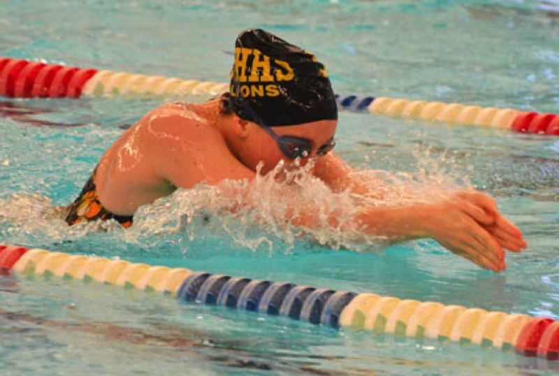 by: JOHN BREWINTON - St. Helens' Jackie Prevish swims in the 200 medley relay during last week's meet with WIlsonville.