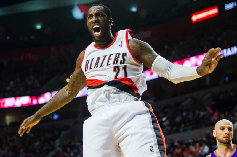 by: TRIBUNE PHOTO: CHRISTOPHER ONSTOTT - Trail Blazers center J.J. Hickson gets excited over a score as Portland beats Phoenix at the Rose Garden.