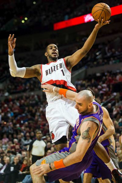 by: TRIBUNE PHOTO: CHRISTOPHER ONSTOTT - Portland forward LaMarcus Aldridge barrels in for two points in the Blazers' victory Saturday night over visiting Phoenix.