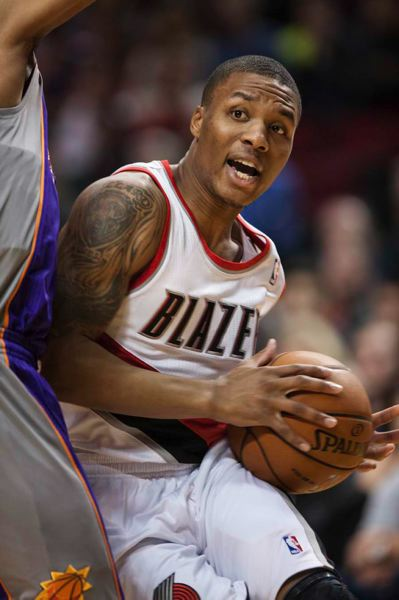 by: TRIBUNE PHOTO: CHRISTOPHER ONSTOTT - Blazers point guard Damian Lillard looks for a lane. Lillard helped Portland rally from a 12-point deficit to beat Phoenix.